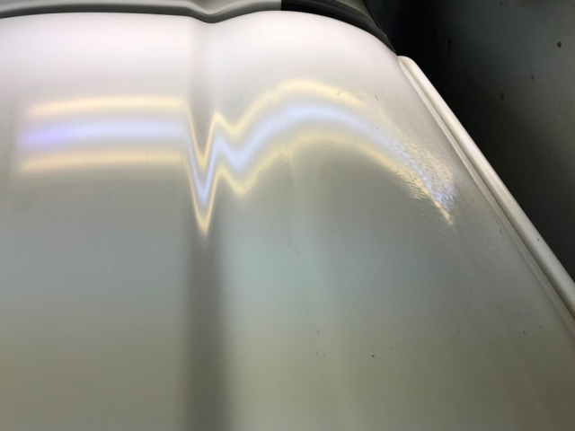 white car fixed dent